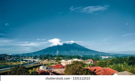landscape morning view to Mount Salak (Gunung Salak) taken beside the highway bocimi (TOL Bogor Ciawi Sukabumi) in Bogor Indonesia.
