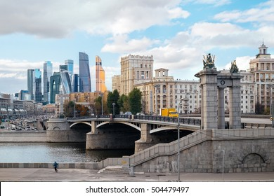 Landscape of Moscow architecture with Borodinsky bridge, old classical buildings and modern city skyscrapers view on background, Russia. Travel Russia, Moscow. Explore Moscow city downtown landmarks