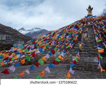 Landscape with Mount Siguniang(Four Girls Mountain, Four Sisters Mountain, Oriental Alps) Stupa and Prayer flag in Ngawa Tibetan and Qiang Autonomous Prefecture, Sichuan Province, China.