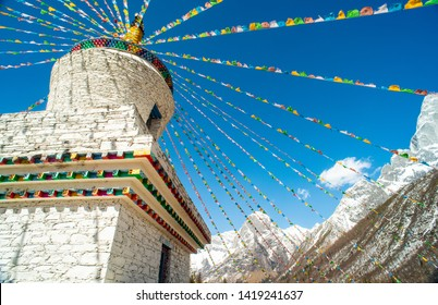 Landscape with Mount Siguniang(Four Girls Mountain, Four Sisters Mountain, Oriental Alps) Stupa and Prayer flag in Ngawa Tibetan and Qiang Autonomous Prefecture, Sichuan Province, China