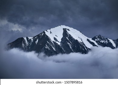 Landscape with mountain above the clouds. Ozerny peak in Tian Shan Mountains in Kazakhstan