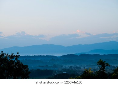 The landscape of mountain with blue sky and the tree om the high view