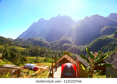 Landscape mountain and forest in the nature with cloud, People walking in the green forest and the big mountain which feeling good in holiday and haven't found in the city life.