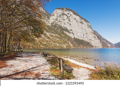 Landscape with mountain lake Königssee in Bavaria, Germany. Beach on the peninuslua Hischau, in the background mountains. Berchtesgaden National Park.