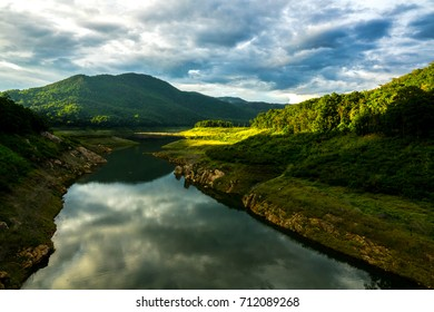 Landscape of mountain and lake before sunset. Landscape view.