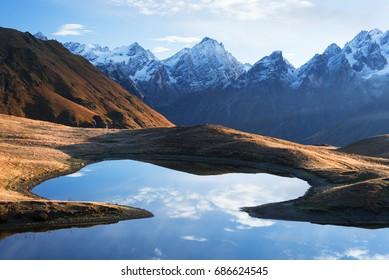 Landscape with a mountain lake. Day with beautiful clouds. Lake Koruldi. Main Caucasian ridge. Zemo Svaneti, Georgia