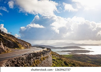 Landscape of mountain road, hills and atlantic ocean. Ring of Kerry, Ireland. Travel destination