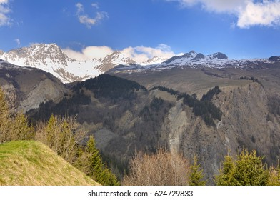 landscape mountain in spring with snowy summit