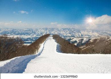 Landscape and Mountain view of Nozawa Onsen in winter with sunrise background  , Nagano, Japan.