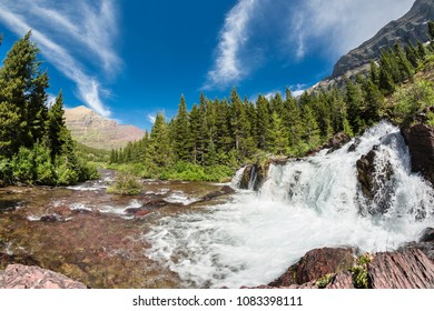 Landscape of a mountain and a waterfall in Glacier National Park (Montana).