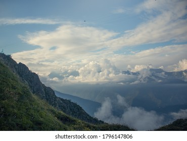 Landscape with mountains and clouds. A bird's-eye view. Early, Sunny morning.