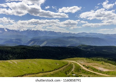 landscape of mountains with a developing road