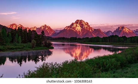 Landscape with mountains, forest and a river in front. beautiful scenery. Beautiful sunset