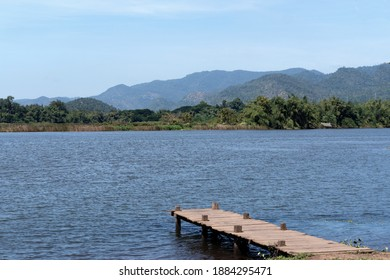 Landscape of the mountains over the river in the national park near the dam over the blue sky clouds with natural relax feeling in the holiday, travel and vacation