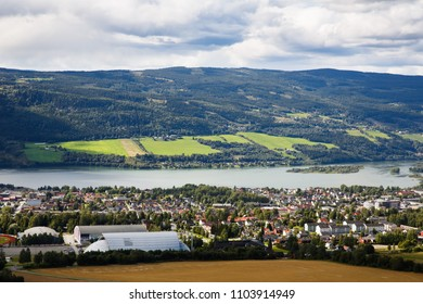 Landscape with mountains, river and buildings in Lillehammer town, Norway.