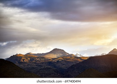 Landscape of Mountains at sunset cloudy sunset sky background in Kyrgyzstan