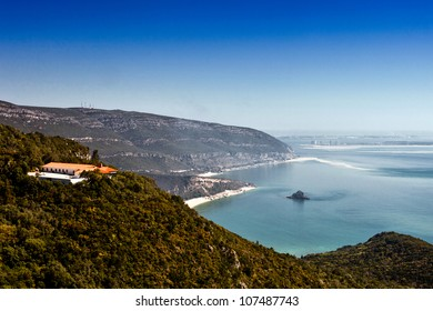 landscape of Nacional Park Arrabida with the Atlantic Ocean in the background.