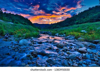 Landscape of Nature stream in the forest at beautiful sunset time