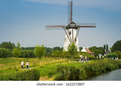 Landscape near the Belgian town of Damme with a typical windmill in the area.