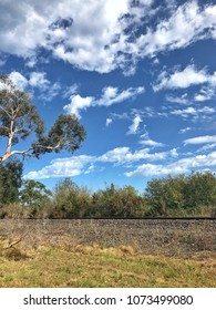 Landscape near Railway line with trees and blue sky with clouds background