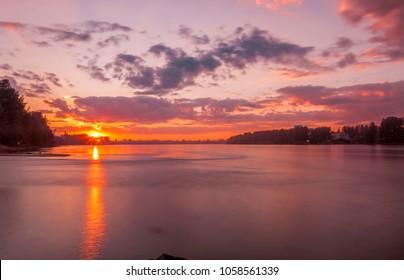 Landscape with Neva river and sunset sky