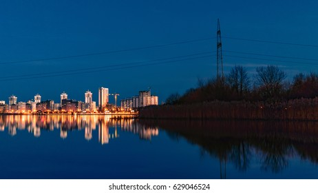 Landscape of the night city and forest
