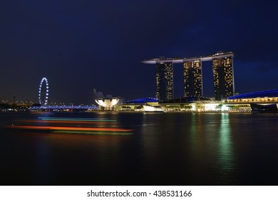 Landscape at night of Marina Bay Sand, Singapore. Including Singapore Flyer, Artscience Museum and Marina Bay Sands Hotel.
