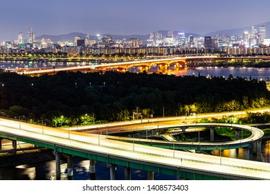 A landscape night view and the trajectory of the vehicle after sunset around the bridge over the Han River, seoul, korea
