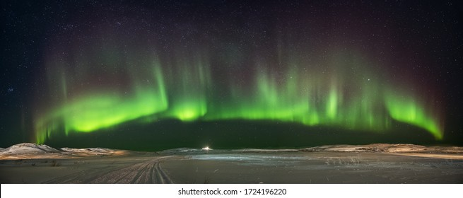 Landscape with northern lights  on the coast of the Barents Sea on the Kola Peninsula at night at high ISO sensitivity. Panoramic view