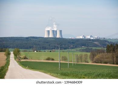 Landscape with a nuclear power plant on the horizon. Temelin, Czech Republic.