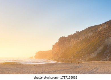 Landscape with the ocean beach at beautiful sunset. Nazare, Portugal