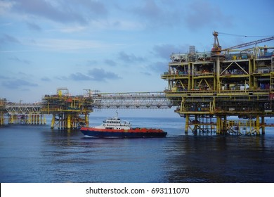 Landscape of offshore platform with sailing of fast crew boat at Baronia Field, South China Sea.