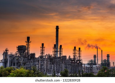 Landscape of Oil and Gas Refinery Manufacturing Plant., Petrochemical or Chemical Distillation Process Buildings., Factory of Power and Energy Industrial at Twilight Sunset., Engineering Petroleum.