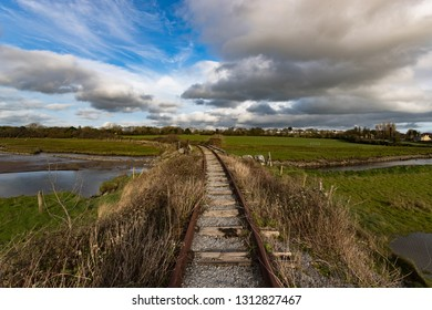 landscape of old unused and abandonned rusty train tracks in rural Ireland