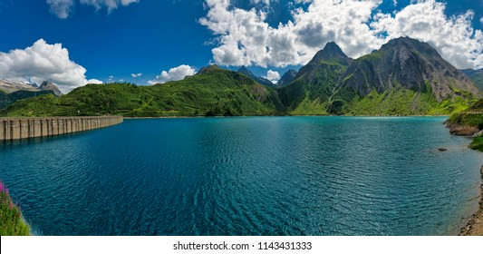 Landscape on the lake of Morasco in summer season with blue sky and clouds in background, Formazza valley - Piedmont, Italy