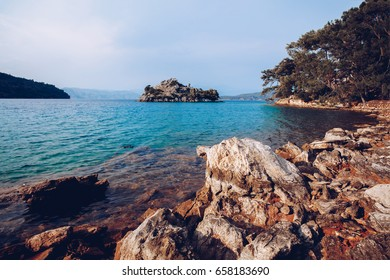 landscape on mediterranean Sea view with rock and stone beach. Paradise place on Dalaman Turkey island. Blue transparent water. Tourism. Travel