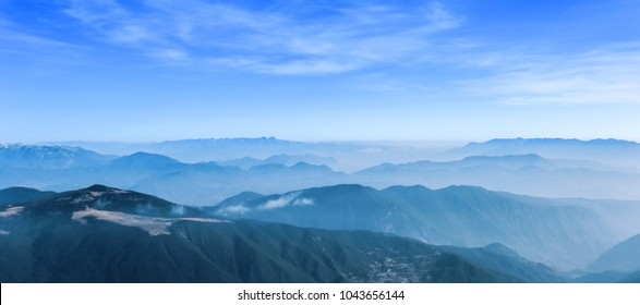 Landscape on a mountaintop overlooking a mountain range in Lijiang, Yunnan Province, China
