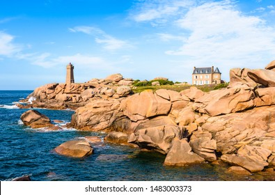 Landscape on the Pink Granite Coast in northern Brittany on the municipality of Perros-Guirec, France, with the Ploumanac'h lighthouse, named Mean Ruz and made of the same pink granite.