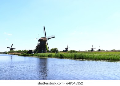 Landscape with one old traditional historic dutch windmill house above the river in the Kinderdijk Park near Rotterdam, Netherlands