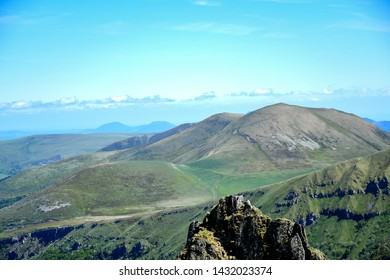 Landscape outdoor with high motain, white clouds and blue sky, cleary day with sunny in summer season, hiking and walking activity to explorer the nature