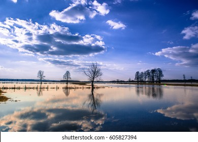 Landscape over the floodplain of a river with a stormy day