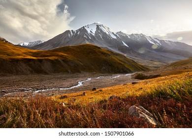 Landscape of Ozerniy peak in Tian Shan Mountains at sunset in Kazakhstan