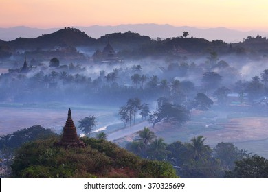 Landscape of pagodas with mist at dawn in Mrauk-U, Myanmar