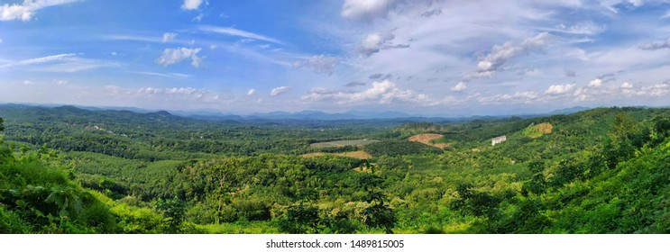 Landscape Panorama of greenery and blue sky with clouds in Kerala, India.