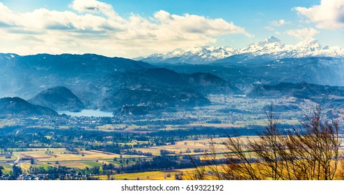 Landscape panorama picture of lake Bled and mountain Triglav in Slovenia. A view of Slovenia biggest landmarks in winter.