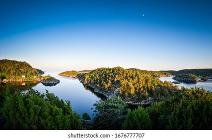 Landscape panorama at sunset with golden hour in a coastal bay of Norway