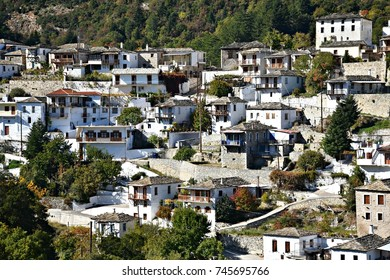 Landscape with panoramic view of Kastanitsa, a traditional historic village and Heritage Site in Arcadia Peloponnese Greece with the typical slate roofs, surrounded by the renowned chestnut forest.