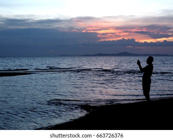 Landscape of paradise  island beach, sunrise shot.Sunset on the ocean, abstract environmental backgrounds with man photography .