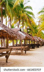 Landscape of paradise tropical island with palms, cottages and white sand beach in Asia