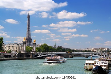 Landscape in Paris. Eiffel Tower, cruise boat on the Seine under Alexandre III bridge